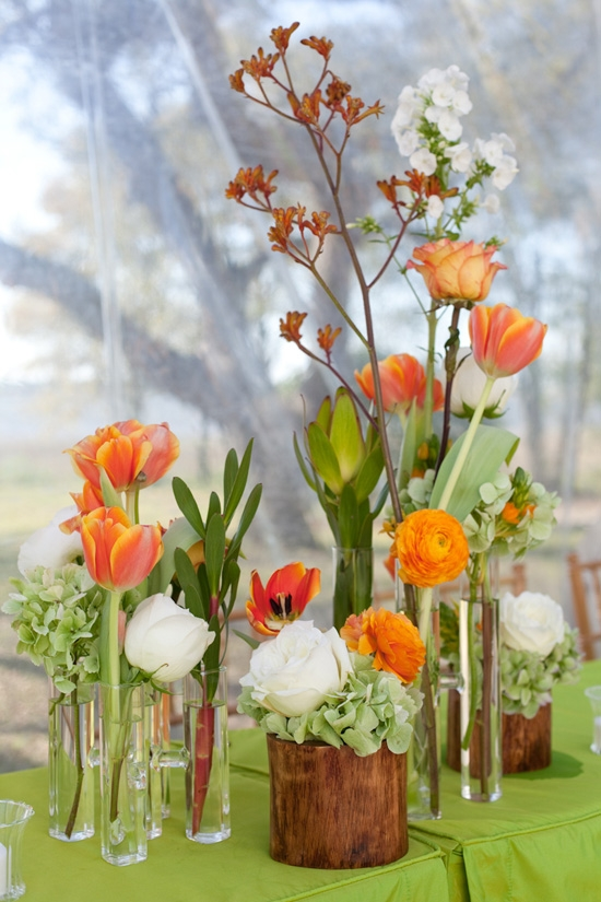 HIGHS AND LOWS: Vases of various heights and in assorted materials gave the mixed flora dynamic flare. Single stems grouped in a cluster like this creates a full centerpiece.