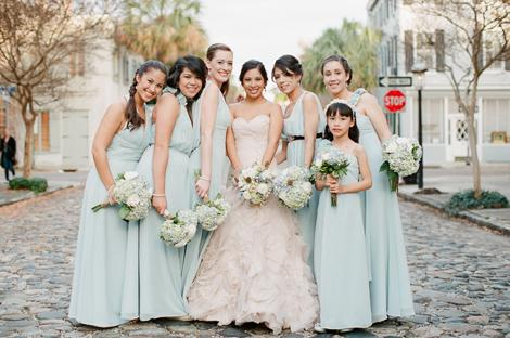 MY GIRLS: Bridesmaids wore pale blue-green Bari Jay gowns in the same sweet colors as the receptions' paper flowers.