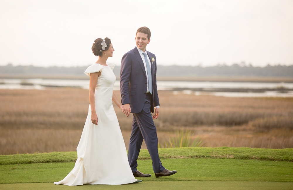 Bride's gown by Delphine Manivet. Menswear by SuitSupply. Photograph by Captured by Kate at River Course at Kiawah Island Club.