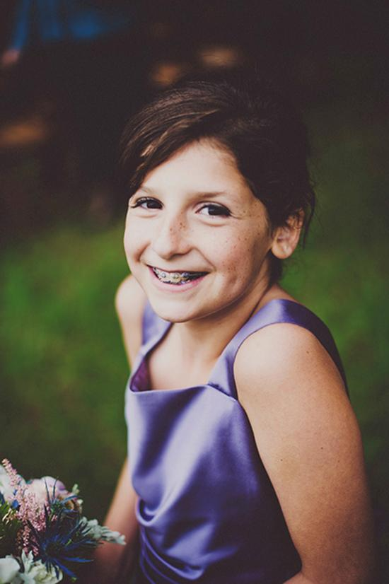 SMILING PRETTY: Junior bridesmaid Lucy, Kris' youngest sister, glowed in a purple satin shift.