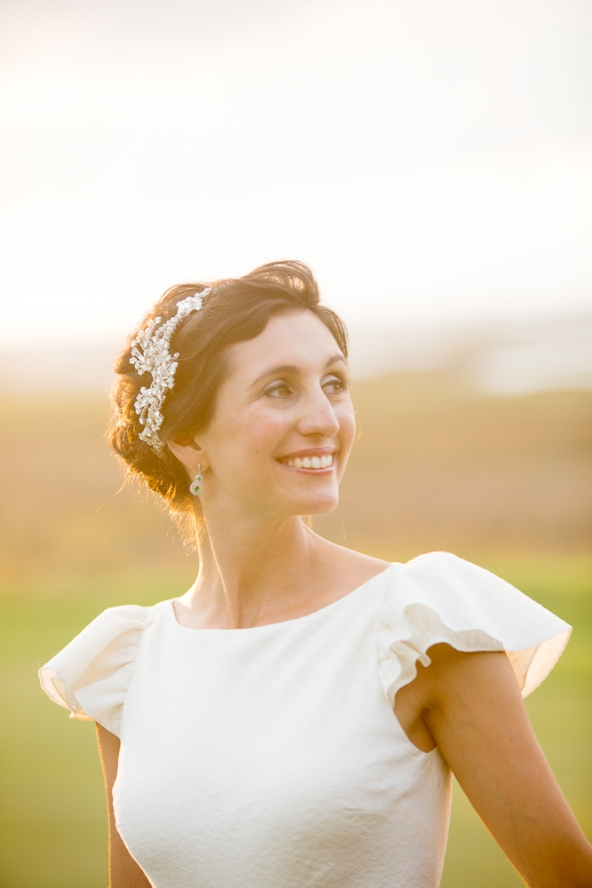 Bride's gownby Delphine Manivet. Hair by Paper Dolls. Makeup by Leslie Moore. Photograph by Captured by Kate.