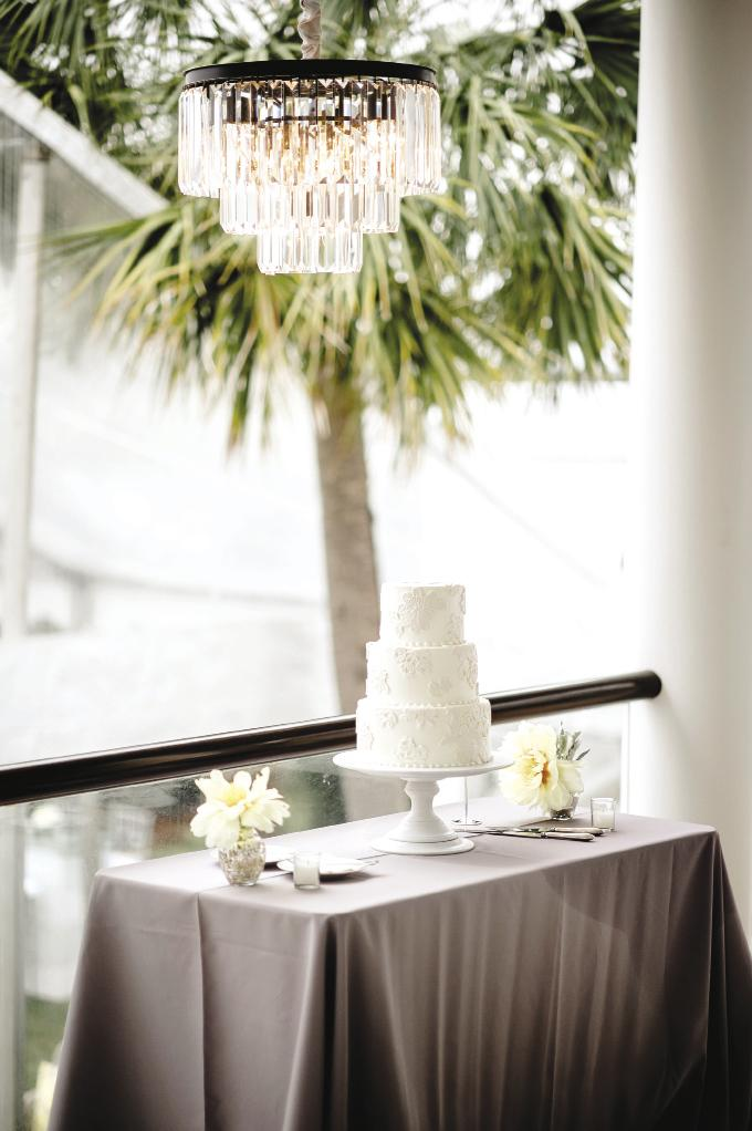 SCENIC OVERLOOK: Display your cake (like this one from Ashley Bakery) on the porch as a precaution against the  weather. Here, a chandelier adds elegance to the setup.