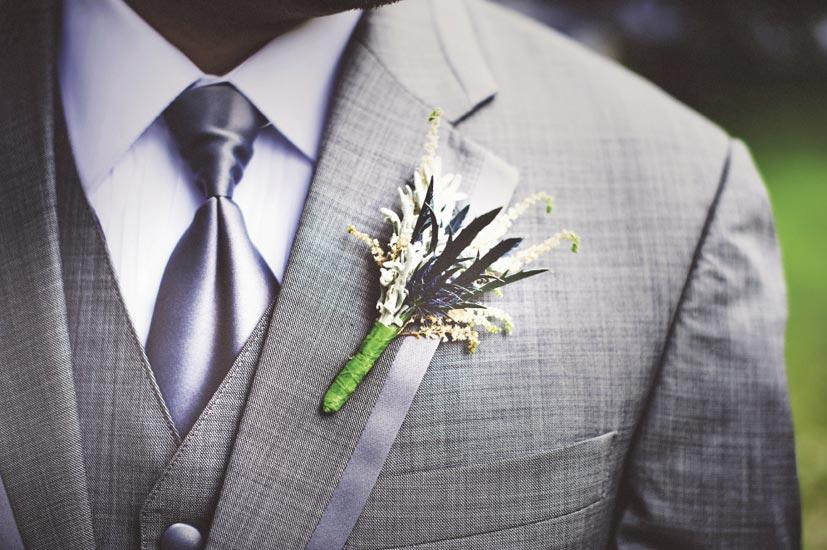 THE PERFECT TOUCH: Jacob's simple thistle and astilbe boutonniere accented his charcoal J.Crew tux.