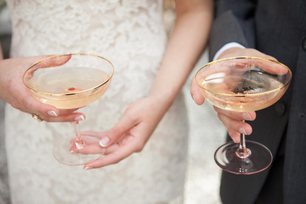 RICH IN LOVE: The couple celebrated with etched champagne coupes—a shape originally designed for English aristocrats.