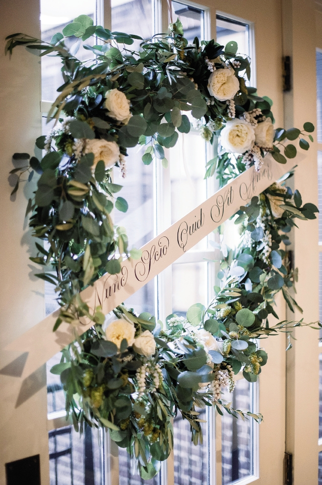 Wreath and sign by Bon Vivant. Image by Timwill Photography at McCrady's Restaurant.