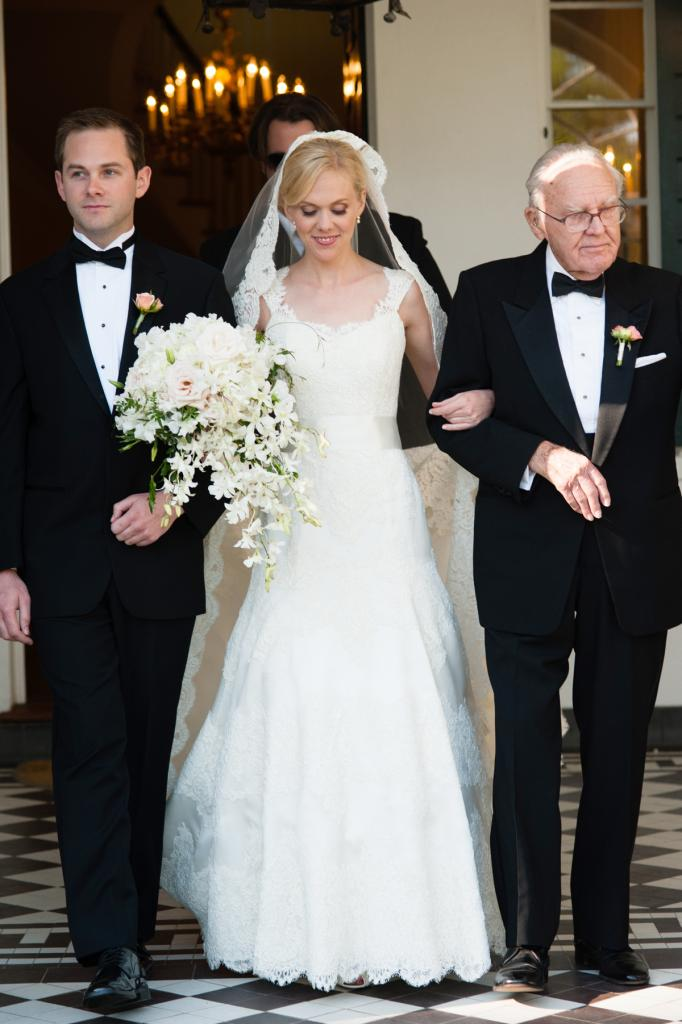 BLUSHING BRIDE: Anna, who was escorted down the aisle by her brother and grandfather, carried a bouquet of white and pale pink r