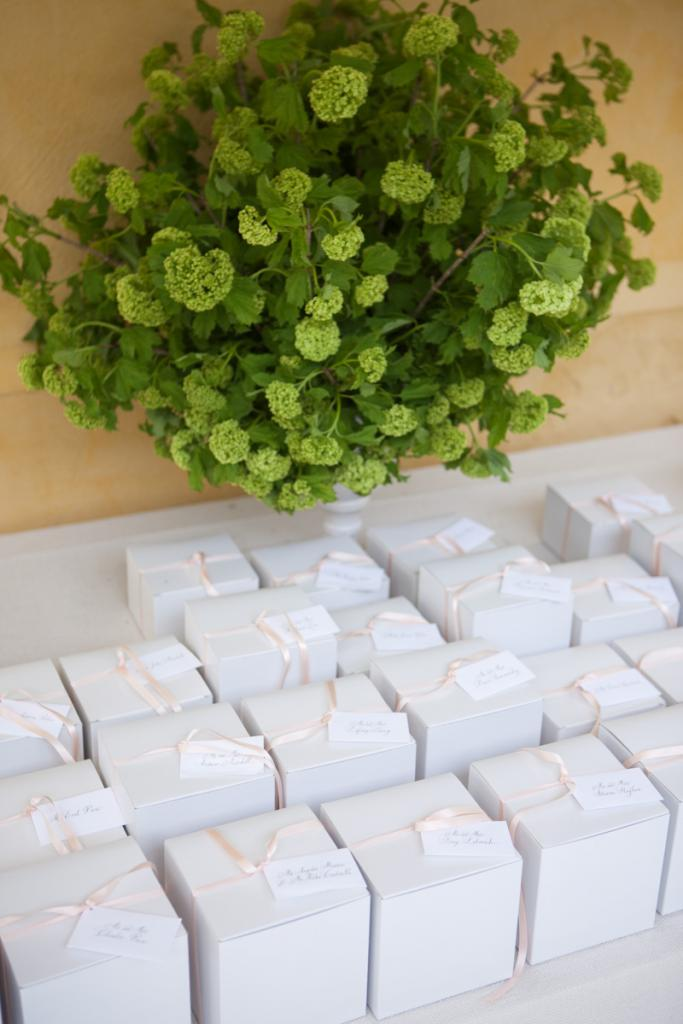 KEEPSAKE: The team at Kristin Newman Designs surprised the couple with favors of teacups and seed packets for each of their guests to take home.