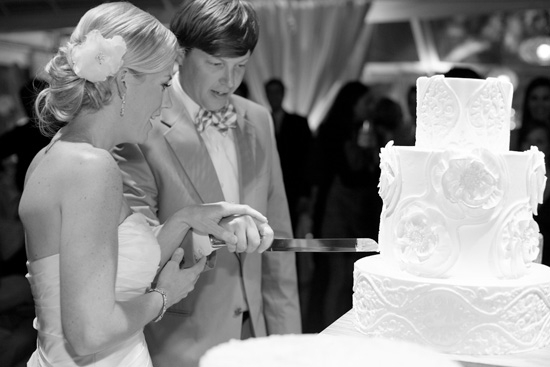 DIG IN! The all-white, three-tiered confection from Weddings Cakes by Jim Smeal was decorated with a trio of patterns pulled from the reception's décor.