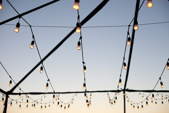 GARLAND GLITTER: Technical Event Company draped strands of globe lights across a tent frame to create a outdoor room.