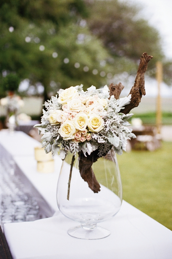 HB Stems married fresh blooms with driftwood pieces; displaying them in glass took the look from rustic to sophisticated.