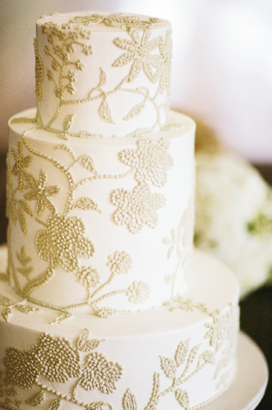 Wedding Cakes by Jim Smeal's buttercream confection sported a pattern inspired by the table linens.