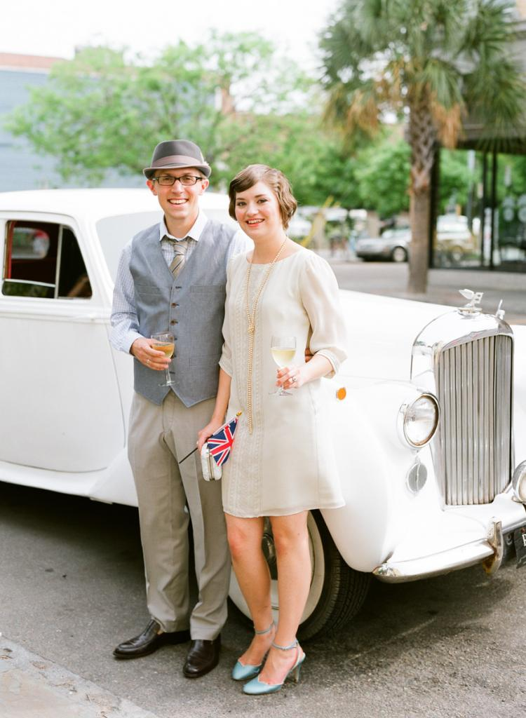CHEERIO: Liz and Matt had a truly British sendoff, complete with a white Rolls Royce and mini Union Jack flags.