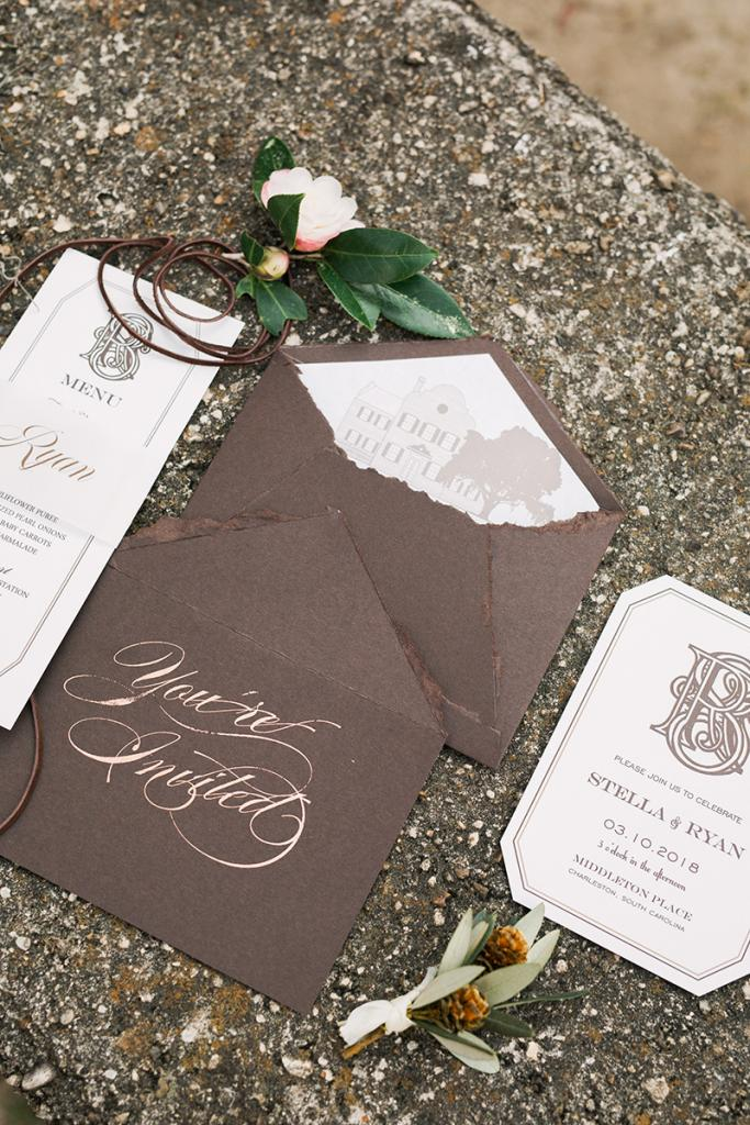 Another perk of a shorter guest list? Custom calligraphy becomes an option for even modest budgets. Here, copper foil ink marks handmade envelopes.