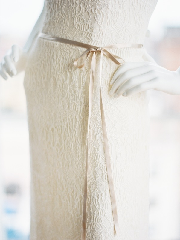 We love the slim ivory bow belt on this head-to-toe lace Kate McDonald gown.