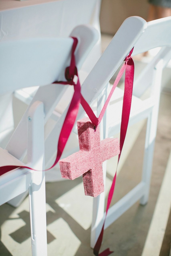 "ARTS & CRAFTS: ""I wanted my wedding to be clean and fresh, with lots of detailed touches,"" says the bride. Wedding designer Heather Carr personalized the space with DIY décor, like these berry-colored plus signs made of yarn, cardboard, newspaper, and tape."