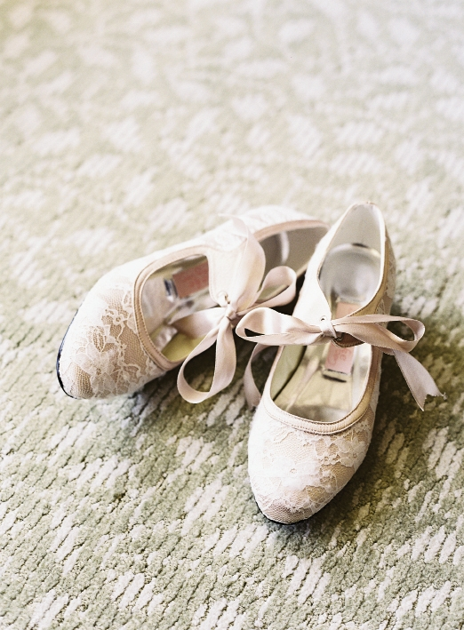 HEAD TO TOE: The bride wore old-fashioned wedding shoes with satin laces custom-made by British company Bespoke Big Day.