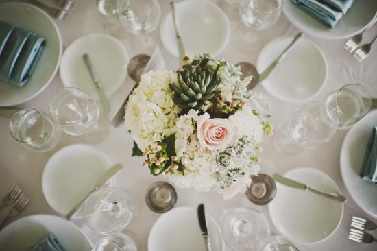 BRIDE'S EYE VIEW: Centerpieces of pink rose, hydrangea, succulent, hypericum berries, and Dusty Miller decorated the tables for the sit-down dinner.