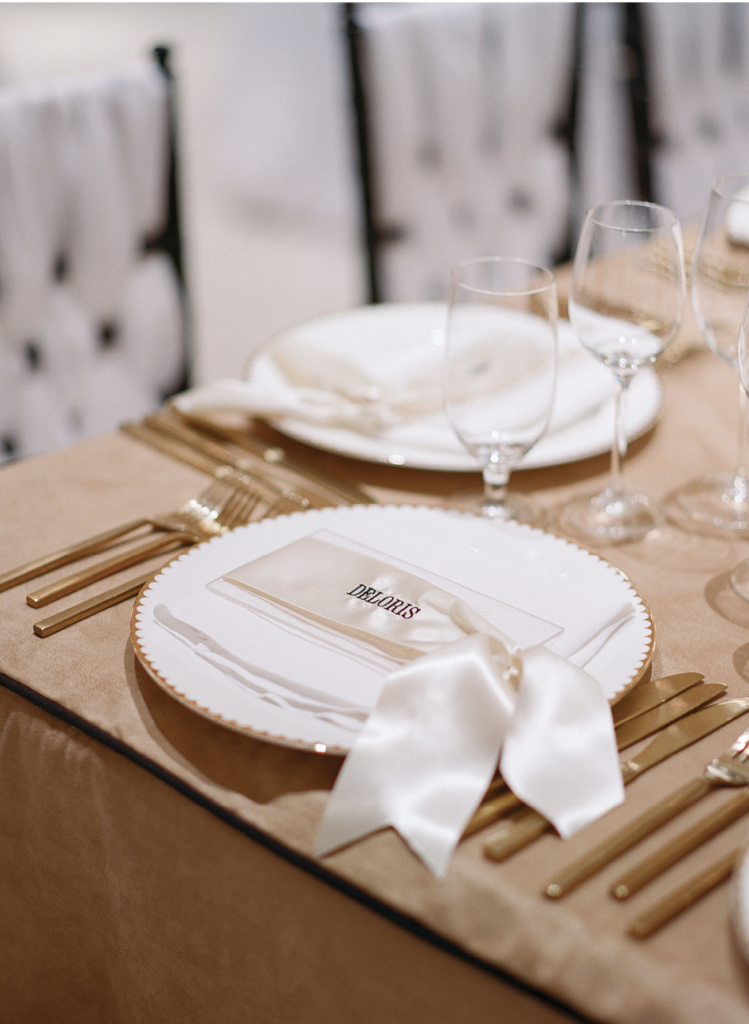 Ribbons, embroidered with guest names to act as place cards, were tied around engraved Lucite menus.    <i>Photograph by Corbin Gurkin</i>