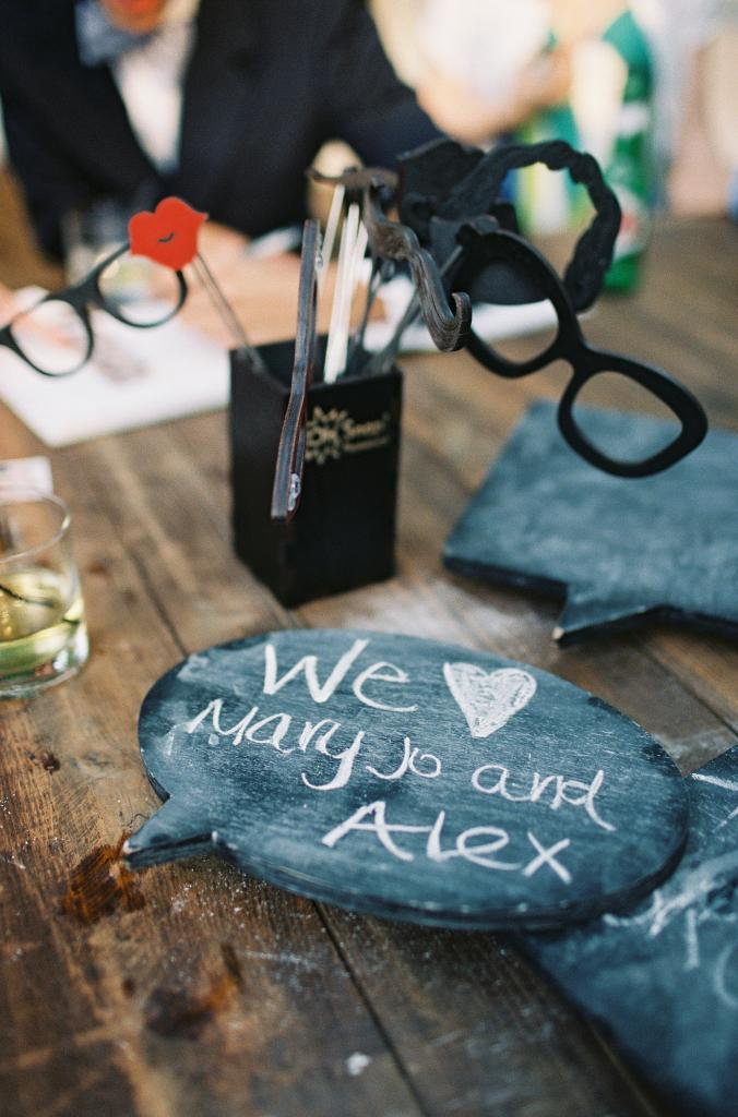 TAKING NAMES: Guests posed with props like novelty glasses and chalkboard conversation bubbles and had their pictures made.