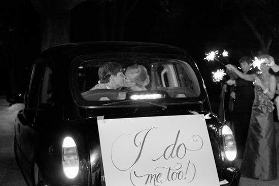 HAPPILY HITCHED: Tyler and Danny rode away in a vintage sedan rented from the Charleston Black Cab Company sporting a custom-made sign.