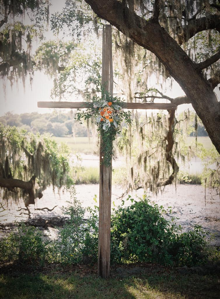 BONDED: A family friend made the wooden cross that marked the ceremony altar.