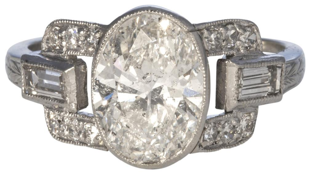 Art Deco 1.66 ct. oval diamond ring with baguette-cut (.29 total cts.) and single-cut (.18 total cts.) diamonds in 14K white gold from Croghan's Jewel Box ($11,500)