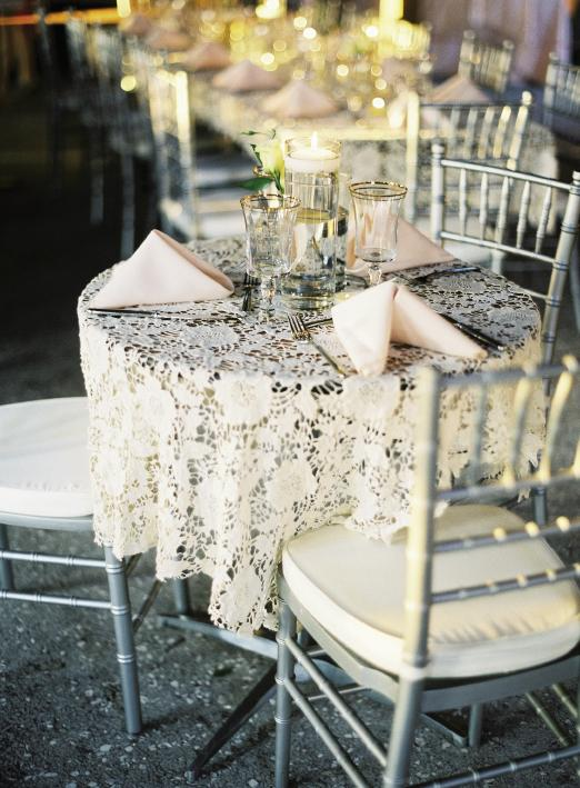 SWEETHEARTS: Mary Jo, Alex, and their daughter, Georgi, shared a table dressed with crocheted lace, pale pink napkins, and gold-rimmed tableware from Event DRS.