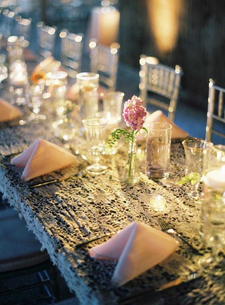 TABLE TALK: Simple tables got a vintage makeover with lace that Mary Jo handpicked and specially ordered for the day. Topped off with single stems, the tablescape offered a pretty but not overpowering place for guests to dine and mingle.