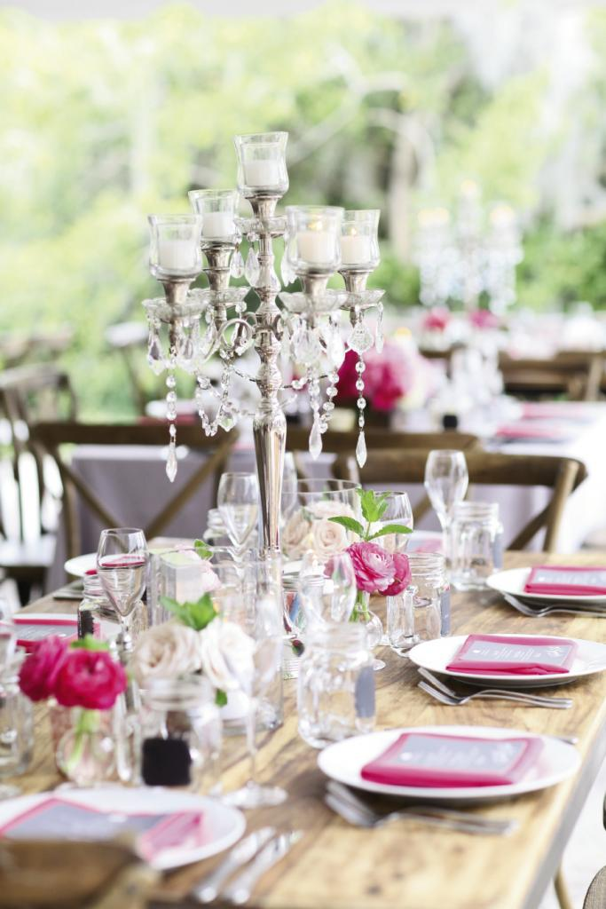 "TABLE TIME: Mason jars joined candelabras on tables. ""Combined with the gorgeous flowers that ranged from white to bright pink, the mix was formal but at the same time, relaxed,"" Michelle says."