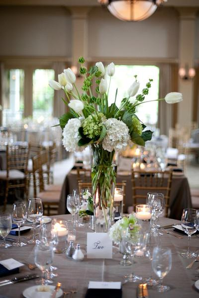 FRESH EFFECT: Beige table linens set the backdrop for arrangements of white tulips and white and green hydrangea.