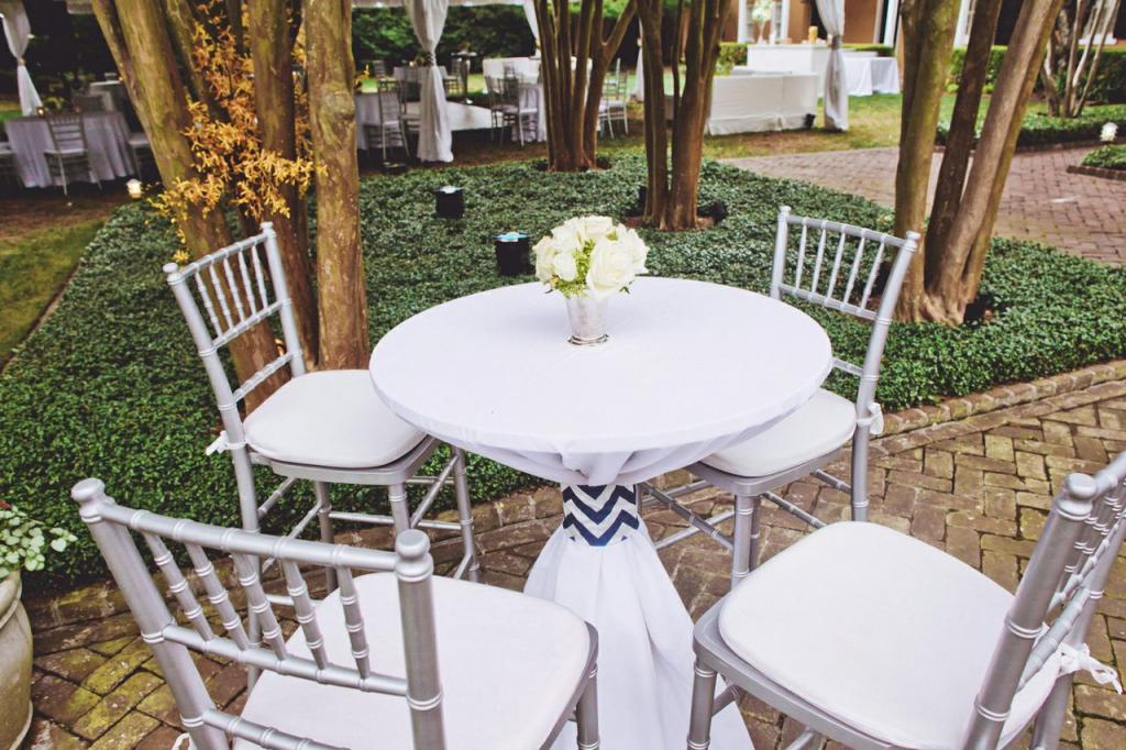TABLE TALK: Chiavari bar stools and silver vessels dressed up cocktail tables.
