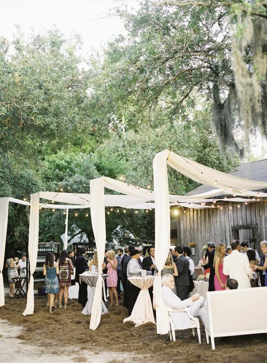GARDEN PARTY: Swaths of hung fabric defined the open-air cocktail area.