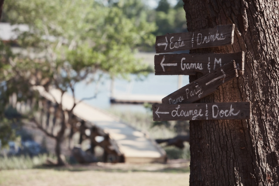 BARK MY WORD: Chalk-written wooden directional posts blended with the tree bark for a playful, outdoorsy effect.