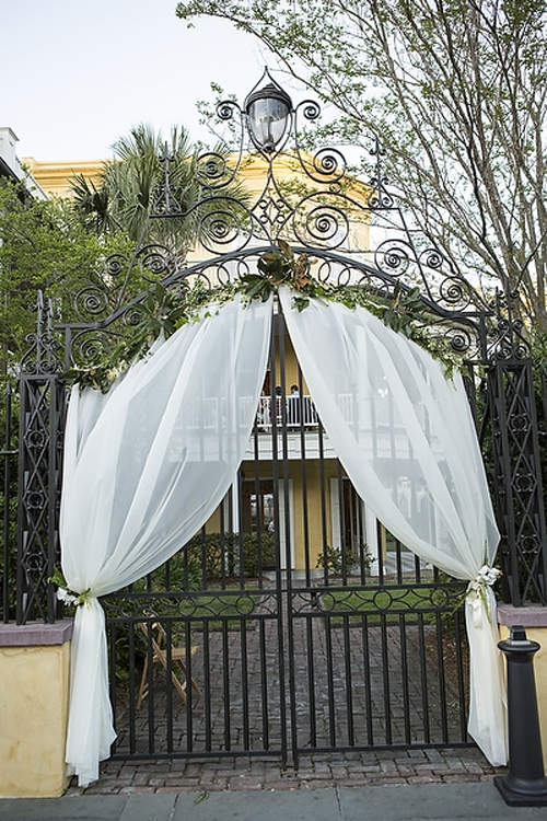 SECRET GARDEN: The William Aiken House's wrought-iron gates dressed in white to match the bride for the Big Day.