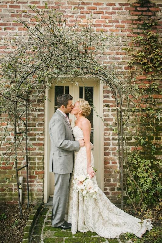 Bridal gown by Anne Barge from Fabulous Frocks. Groom's suit by Jos. A. Bank. Bouquet by Branch Design Studio. Image by Juliet Elizabeth Photography at the Confederate Home and College.