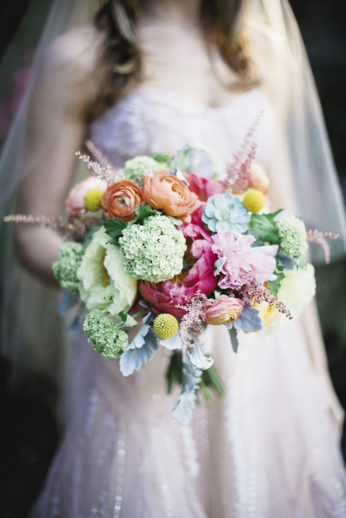 BREATH OF FRESH AIR: For a garden-style bouquet, Whitney gathered astilbe, craspedia, dusty miller, ranunculus, succulents, green viburnum, blush coral charm,  and yellow tree peonies together.