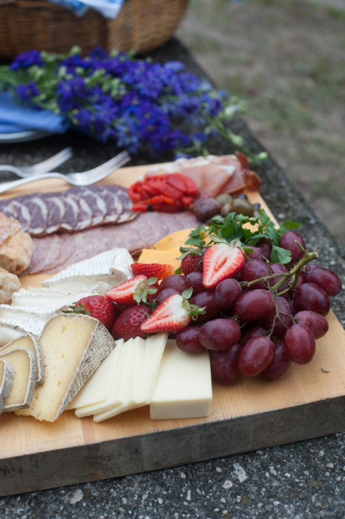 Cheese plate from Caviar & Bananas. Flowers by Tiger Lily Weddings. Photograph by Leigh Webber at Middleton Place.