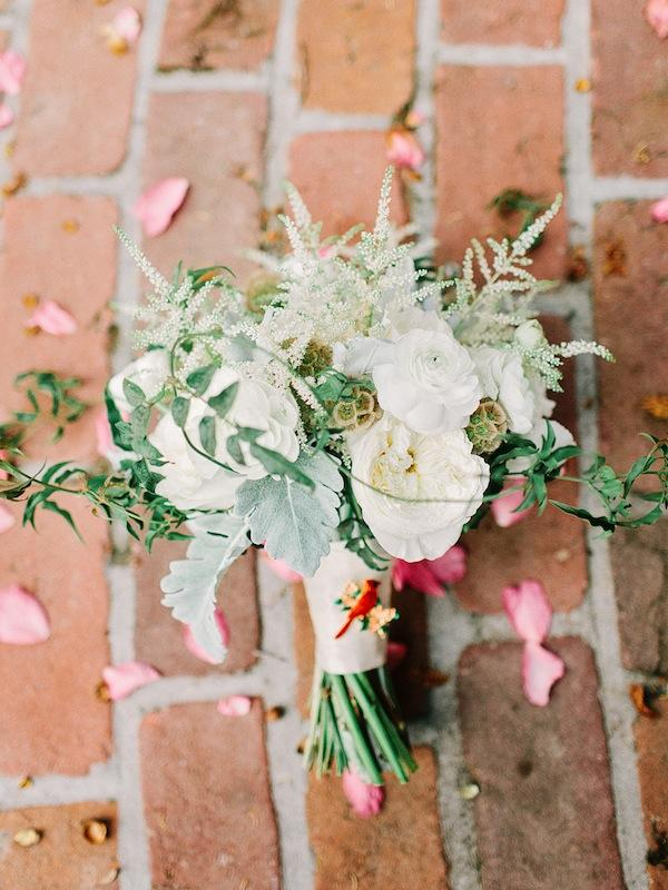 Whitney Randall of Branch Design Studio made a feminine bouquet of astilbe, anemones, garden roses, ranunculus, and scabiosa pods mixed with dusty miller and jasmine vine.