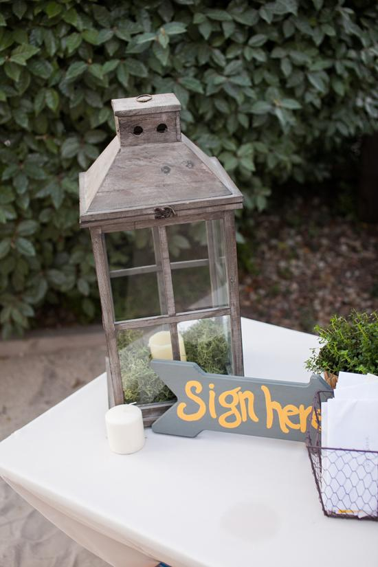 FOLLOW DIRECTIONS: Roughly 90 percent of the wedding was crafted by Sara, Josh, and their friends and family, including signs like this one.
