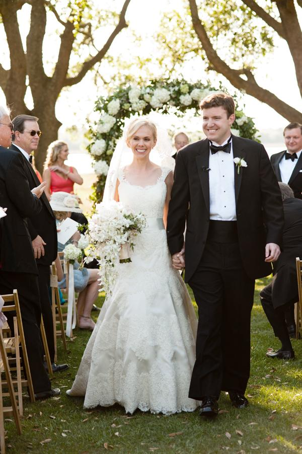 MR. AND MRS.  David's classic suit complemented Anna's lace Anne Barge gown.