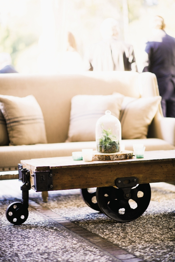 "ALL THE TRIMMINGS: Katie Poole of Tusk Events helped the couple handpick antique furnishings from Ooh! Events, like this trolley table. ""The décor felt easy, eclectic, and personal to Lindsay and Brian,"" says Katie. ""Their event was a true labor of love."""