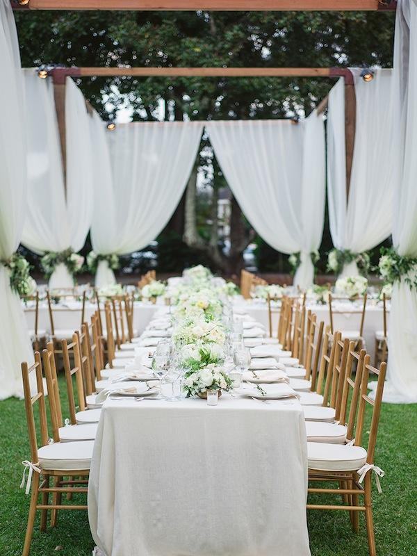 Wedding design and coordination by Easton Events. Structure and lighting by Technical Event Company. Rentals from Snyder Events. Florals and draping by Sara York Grimshaw Designs. Linens from La Tavola. Image by Virgil Bunao Photography at Lowndes Grove Plantation.