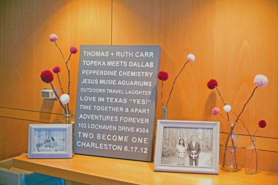 PERSONAL STYLE: Thoughtful details like quote boards, framed black and white photographs, and yarn pom pom flowers decorated the aquarium's banquet room for the reception.