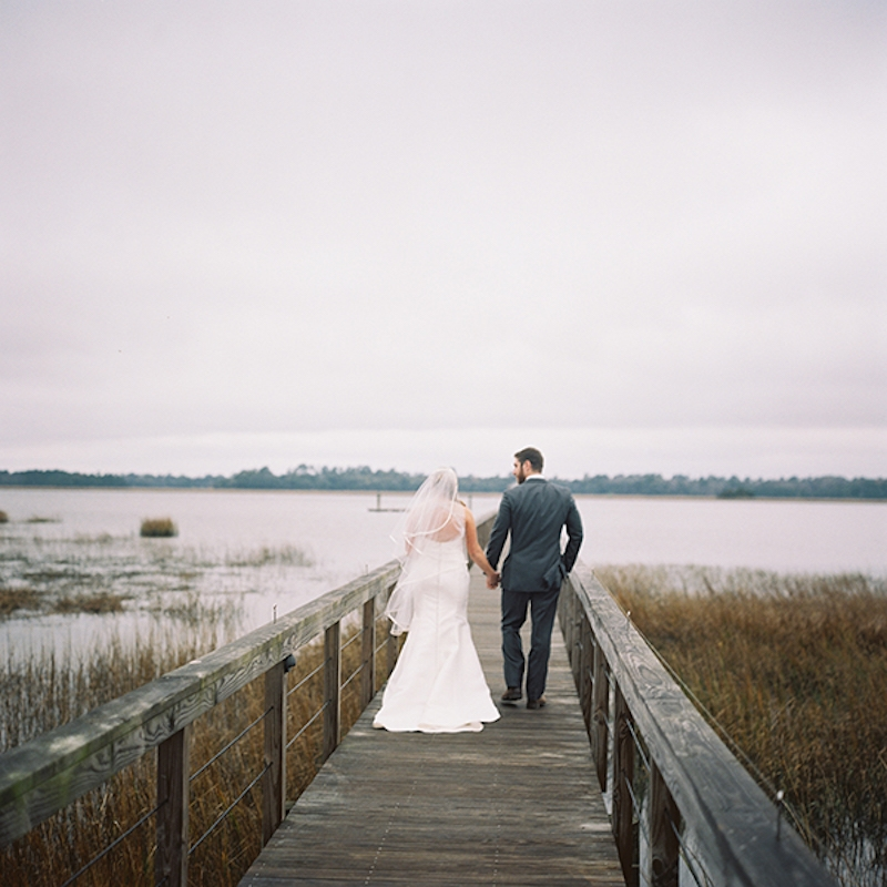 Bride's gown by Amsale from White on Daniel Island. Menswear by Vera Wang from Mens Wearhouse. Image by Virgil Bunao Photography at Lowndes Grove Plantation.