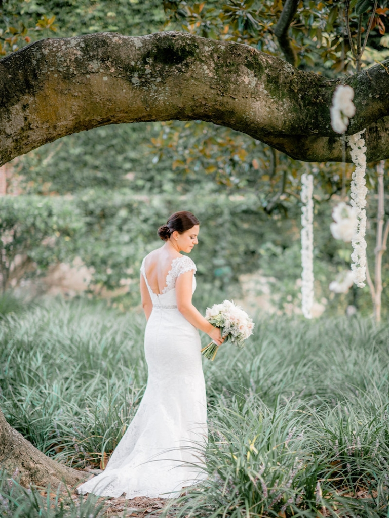 Florals by Out of the Garden. Bride's gown by Romona Keveza, available in Charleston through Maddison Row. Photograph by Brandon Lata at the William Aiken House.