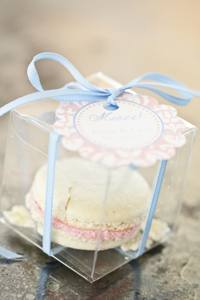 SWEET SET: For continuity, the same ribbon that bound the guides tied off the favors and the macaroons' pink tags (and filling) repeated the same cheery pink seen on the dinner chargers.