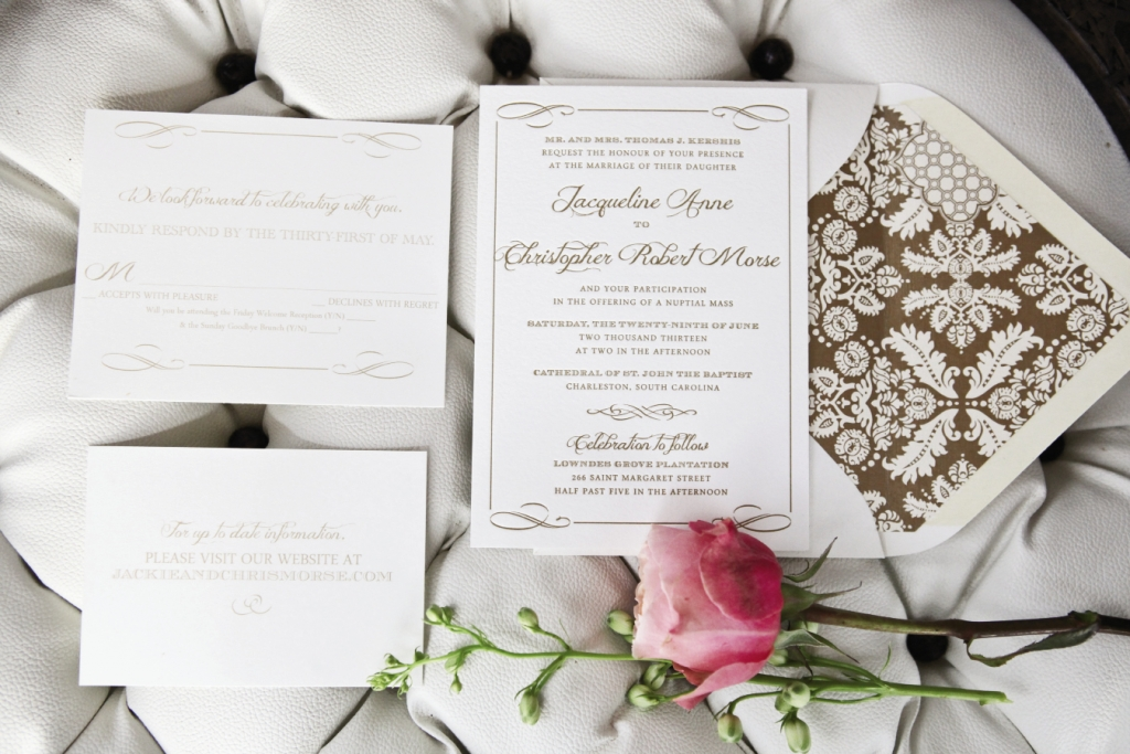 A HANDSOME HELLO: Invitations picked up on the scrolls of reception china.
