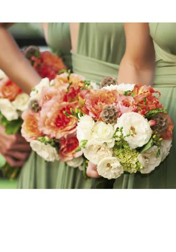 What a Handful: Terri Tezza of Ooh! Events assembled bridesmaids bouquets of geraniums, mango gloriosa, marsh grass, orange freesia, persimmon roses, and scabiosa pods.