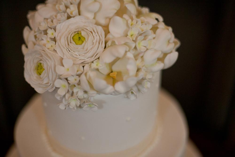 TOP THAT: The dessert was embellished with the couple's custom monogram and Swiss dots.