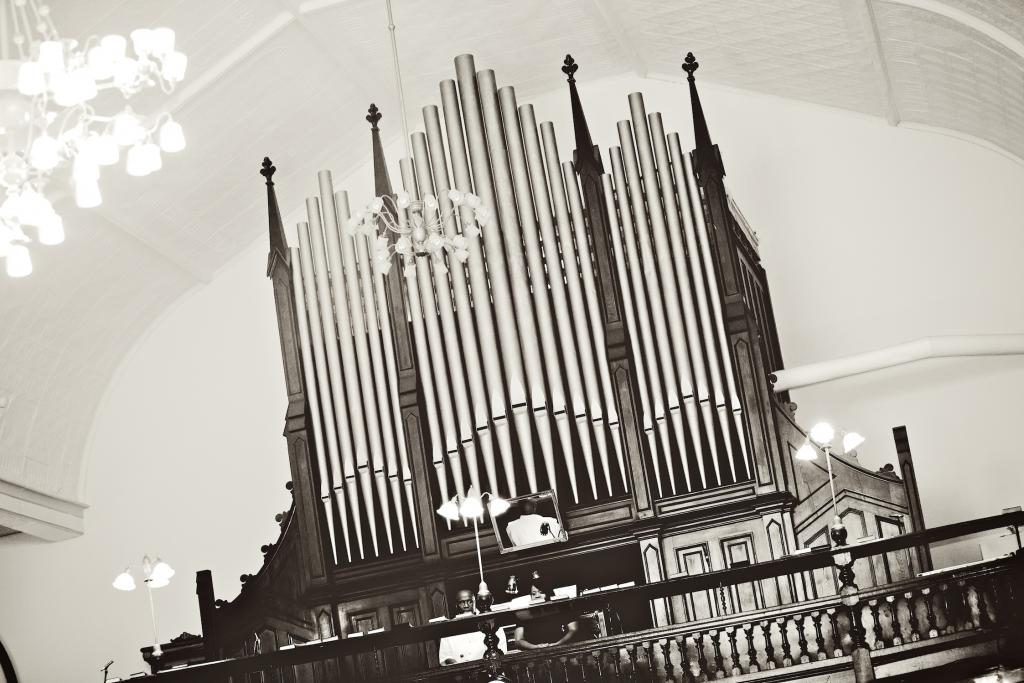 HARMONIOUS TUNES: The church's grand organ and three soloists provided music for the ceremony.
